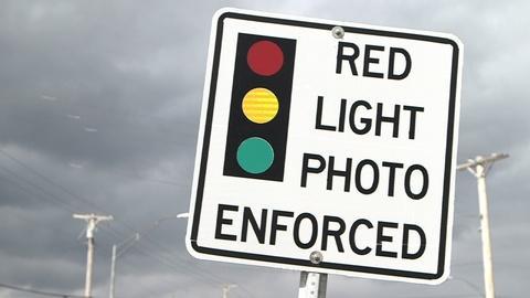 PBS NewsHour -- Do traffic cameras save lives or violate due process?