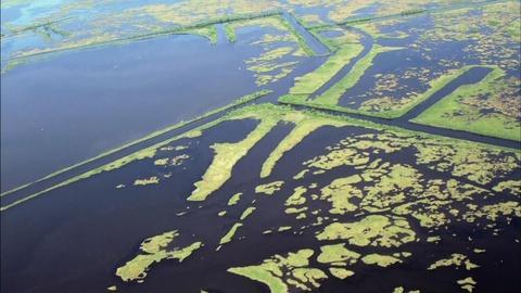 PBS NewsHour -- As Louisiana's coast shrinks, a political fight grows