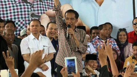 PBS NewsHour -- Polarizing candidates vie for presidency in Indonesia