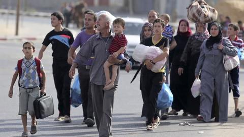 PBS NewsHour -- Residents flee Northern Gaza after Israel warns of strikes