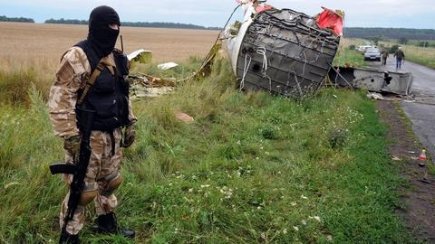 PBS NewsHour -- MH17 crash in war zone poses security challenges