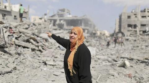 PBS NewsHour -- During cease-fire, Gaza residents survey destruction