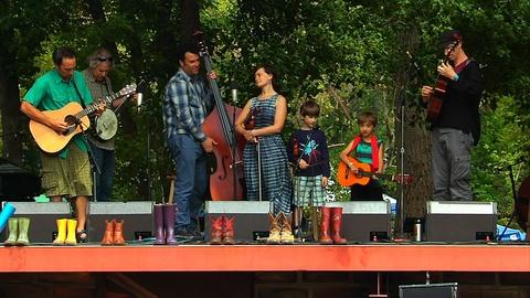PBS NewsHour -- Flood-displaced musicians perform 'Smile' at RockyGrass