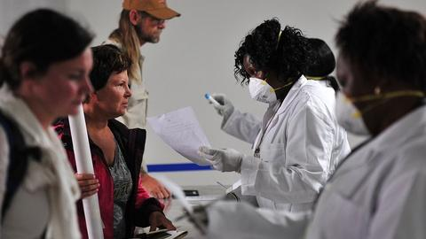 PBS NewsHour -- Can airport screenings curb the spread of Ebola?