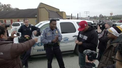 PBS NewsHour -- Security boosted in Ferguson ahead of grand jury decision