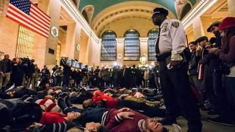 PBS NewsHour -- Protests, largely peaceful, continue over killings by police