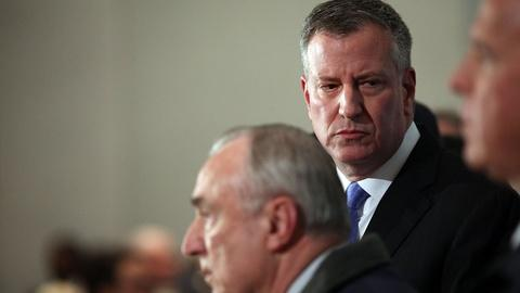 PBS NewsHour -- NYPD officer killings expose rift between police and mayor