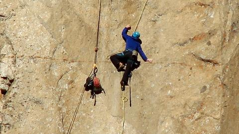 PBS NewsHour -- Yosemite free climbers complete their gripping feat