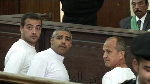 PBS NewsHour -- What's next for two journalists still imprisoned in Egypt?