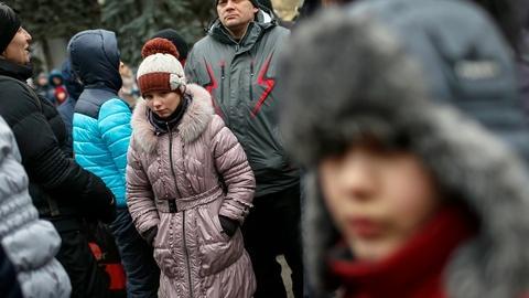 PBS NewsHour -- Humanitarian crisis growing in Ukraine as civilians exit