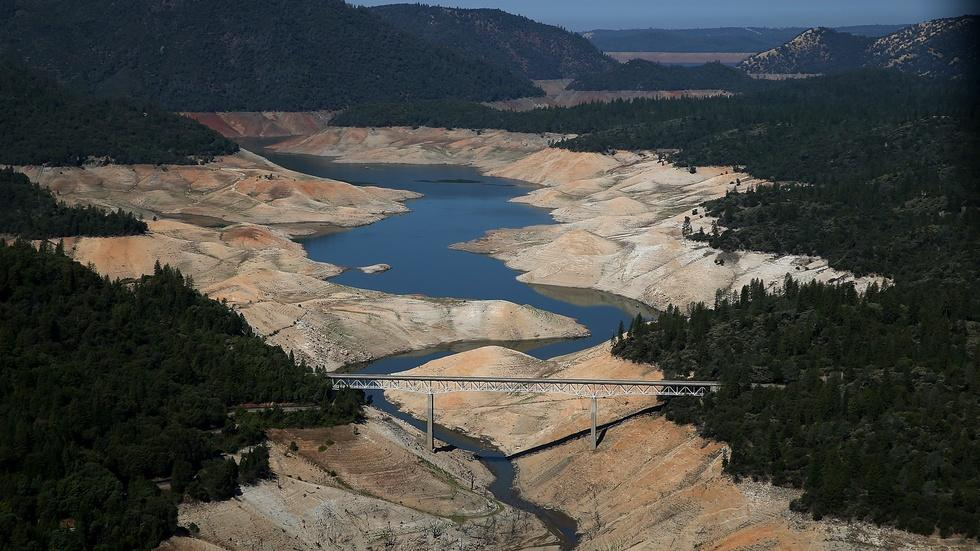 California announces mandatory restrictions to curb drought image
