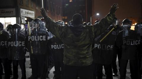 PBS NewsHour -- Protesters in Baltimore clash with police over Freddie Gray