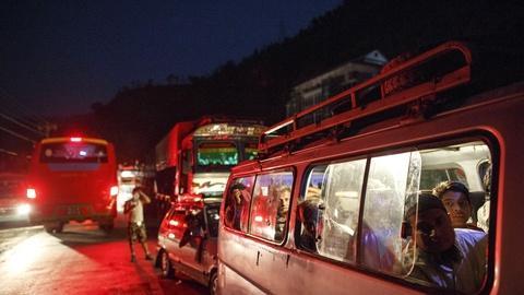 PBS NewsHour -- Traffic-choked road to Nepal earthquake epicenter slows aid