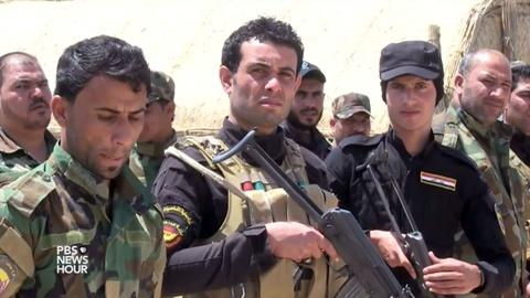 PBS NewsHour -- Shia militias answer the call to fight Islamic State in Iraq