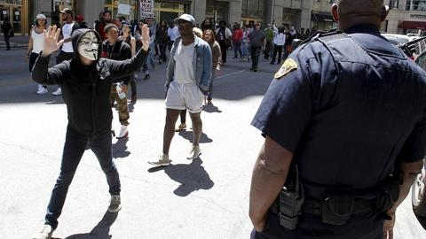 PBS NewsHour -- Protests simmer, but Cleveland calm after cop's acquittal