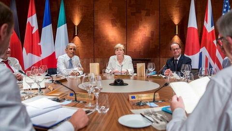 PBS NewsHour -- Greece and Russia dominate the G-7 summit 2-day talks