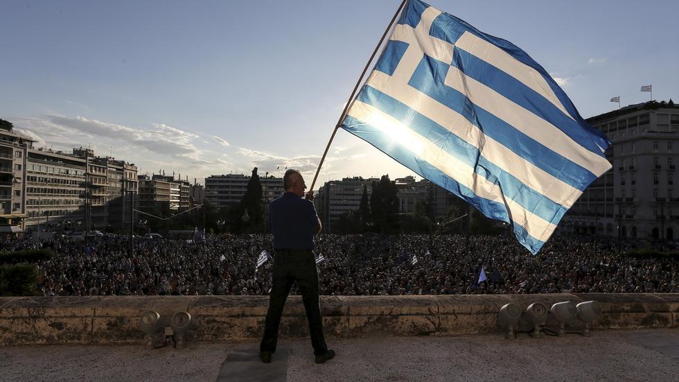Awaiting debt deal, Greeks resist expected reforms image