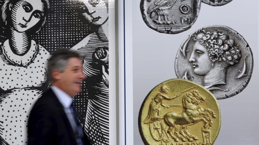 Deal struck, pain and political hurdles ahead for Greece image