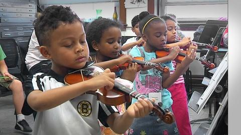 PBS NewsHour -- Transforming Boston's untapped talent into mini maestros