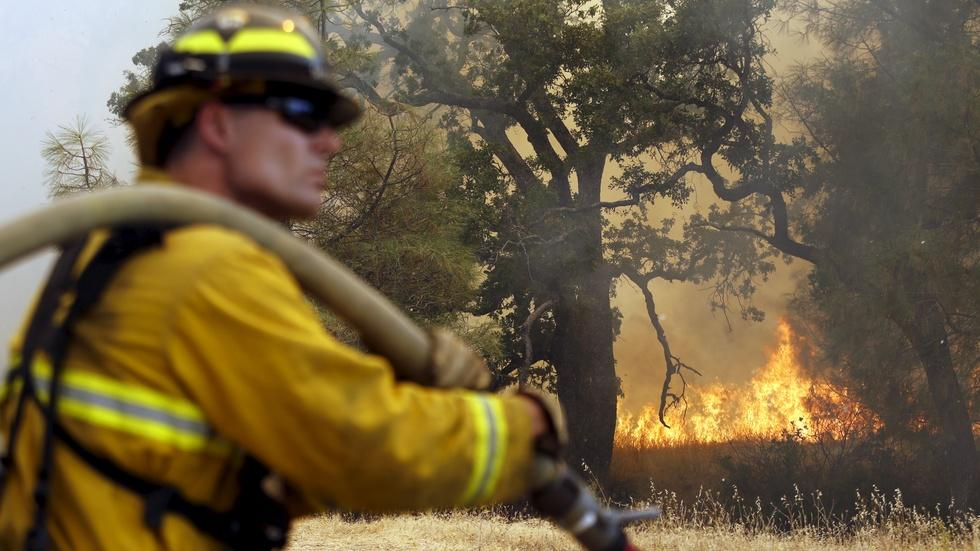 Why California's fires are burning longer and harder image