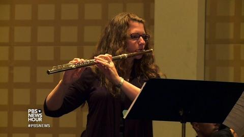 PBS NewsHour -- Thousands gather for a big flute blowout