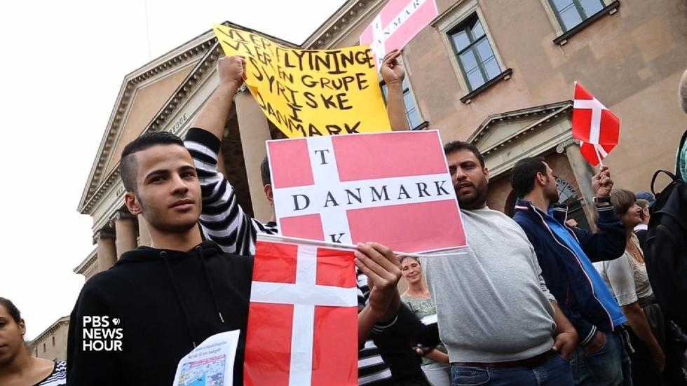 Neighbors Sweden and Denmark split over taking refugees image