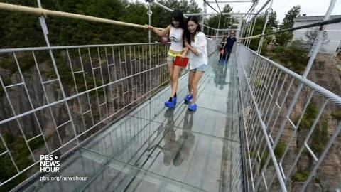 PBS NewsHour -- 'Brave Man's' glass bridge offers vertigo-inducing views