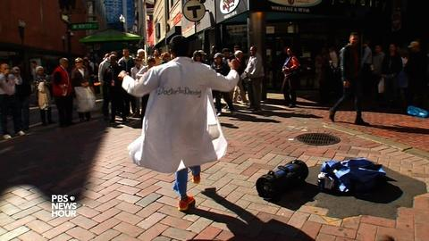 PBS NewsHour -- Donning his white coat, this doctor dances for dollars