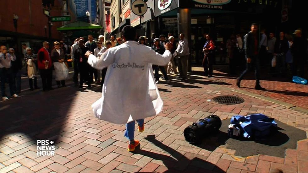 Donning his white coat, this doctor dances for dollars image