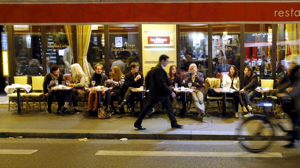 Parisians fight terror with a simple act: returning to cafes image