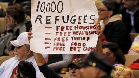 PBS NewsHour -- Debate over refugee crisis sharpens on the campaign trail