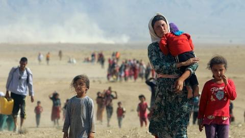 PBS NewsHour -- Iraq's Yazidi's return home to Sinjar