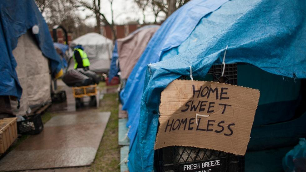 Residents react as their tent city is dismantled image