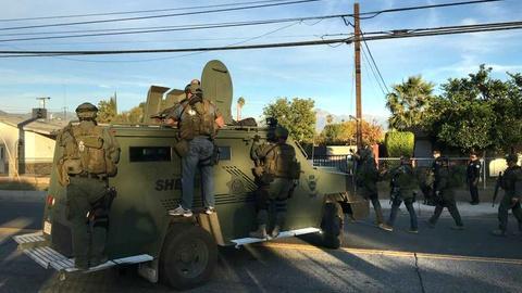 PBS NewsHour -- San Bernardino attack suspects killed in police shootout
