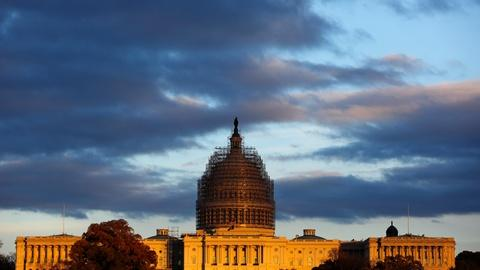PBS NewsHour -- News Wrap: Congress buys time with short-term spending bill