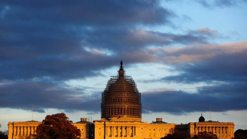 News Wrap: Congress buys time with short-term spending bill image