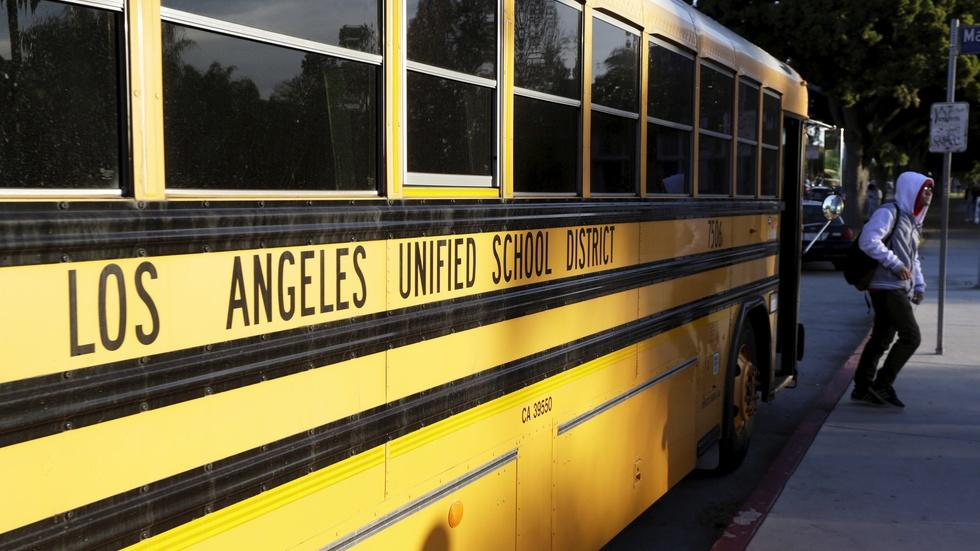 News Wrap: LA students return to school after threat hoax image