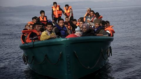 PBS NewsHour -- Facing migrant crisis, Lesbos fishermen now fish for people