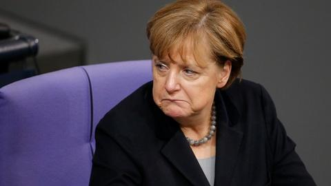 PBS NewsHour -- Merkel's open-door policy, popularity tested by attacks