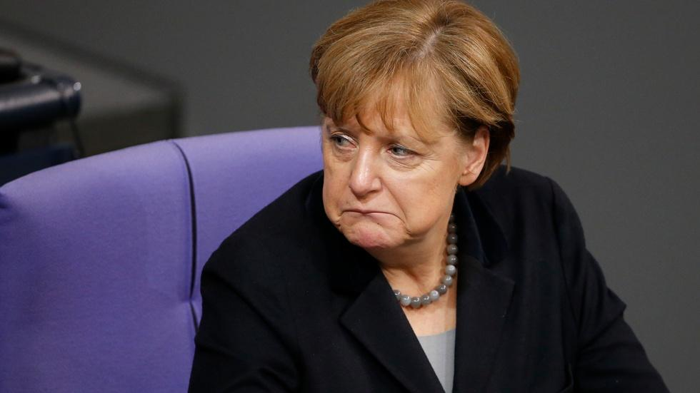 Merkel's open-door policy, popularity tested by attacks image