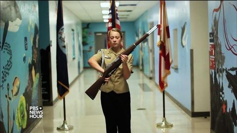 PBS NewsHour -- Female cadet commands respect at her high school