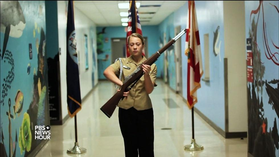 Female cadet commands respect at her high school image
