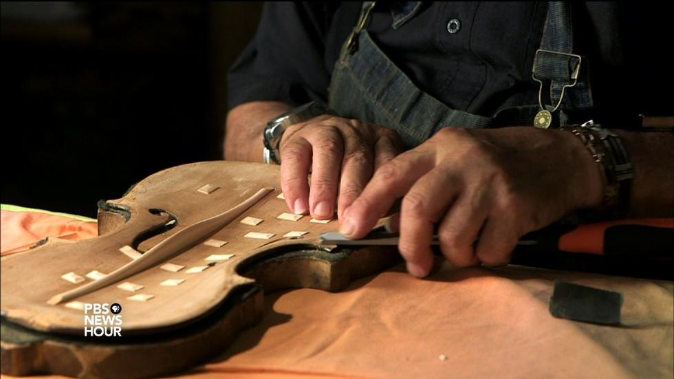 Restoring hope by repairing violins of the Holocaust image