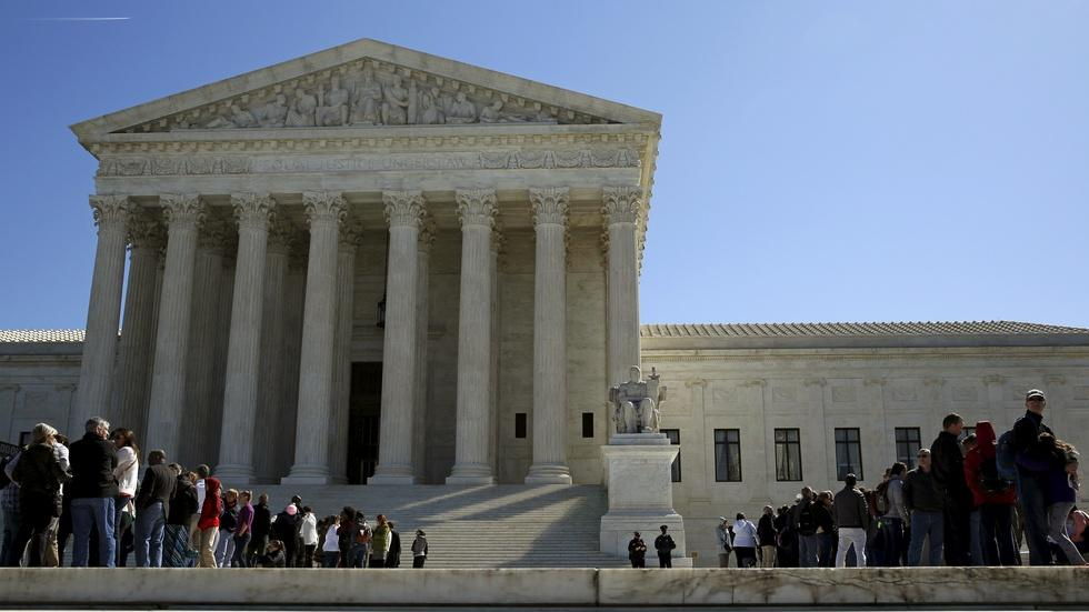 Without Scalia, Supreme Court splits on union fees case image