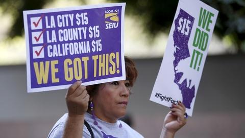 PBS NewsHour -- News Wrap: N.Y., Calif. to adopt nation's top minimum wage