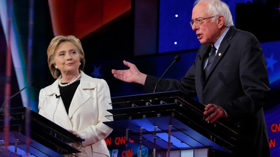 Clinton, Sanders spar in debate; GOP argues over delegates image