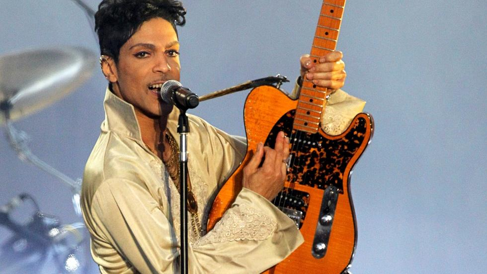 Watch Prince wail on 'While My Guitar Gently Weeps' image