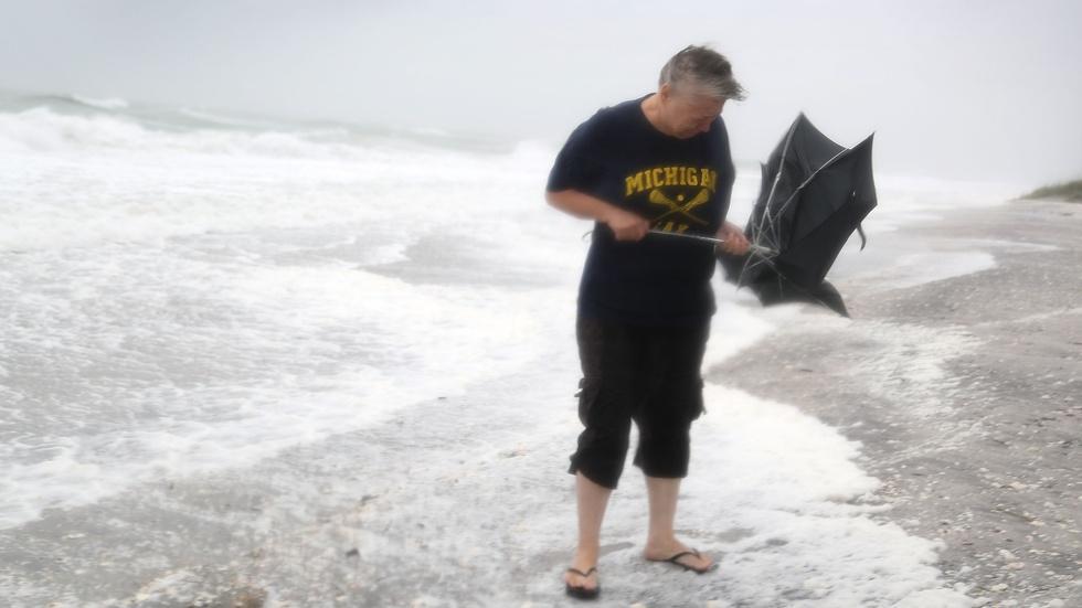 News Wrap: Tropical storm slams FL; Syrian forces make gains image