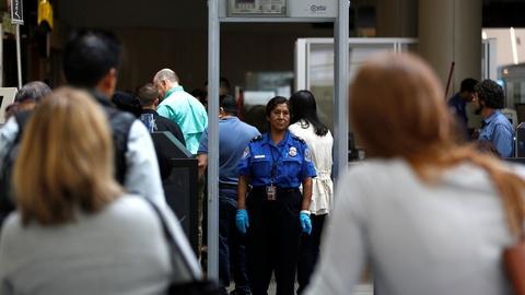 PBS NewsHour -- Traveling Americans confront long TSA lines, terrorism fears