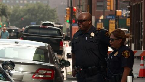 PBS NewsHour -- What is it like to be a black police officer in America?